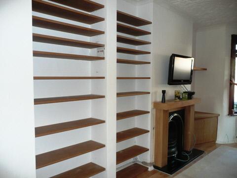 custom shelves for books on the lower shelves and dvds and cd